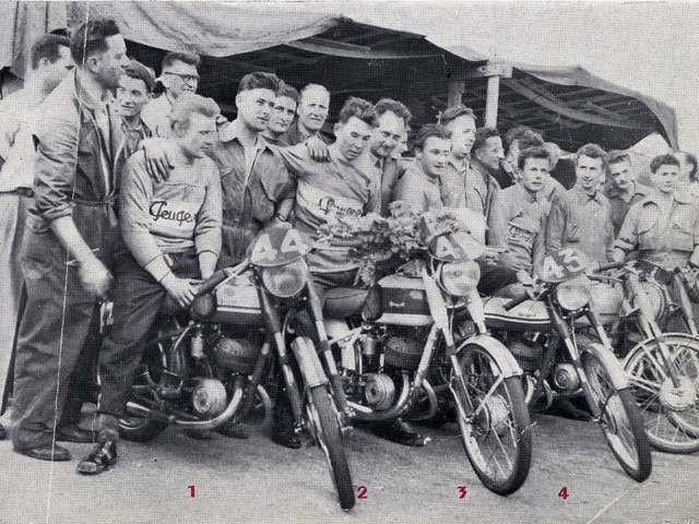 Two-wheelers – 1952 men celebrating the P176 motorcycle victory