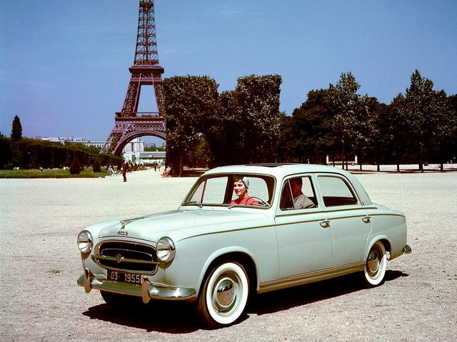 Two centuries of innovation – couple in Paris in a 403, launched in 1955