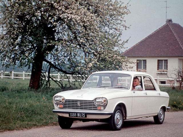 Two centuries of innovation – 1965, woman at the wheel of a white Peugeot 204